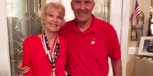woman and man wearing red white and blue clothing
