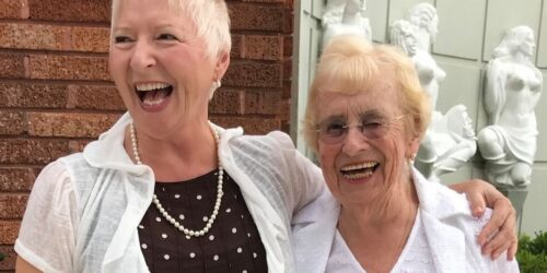younger and older woman laughing